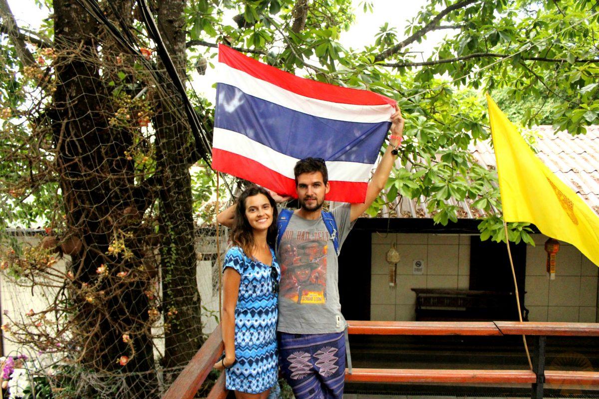 With the Thai flag
